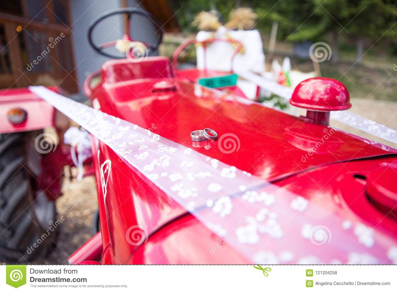 Wedding Rings On A Red Tractor In Rustic Wedding Decoration Stock ...