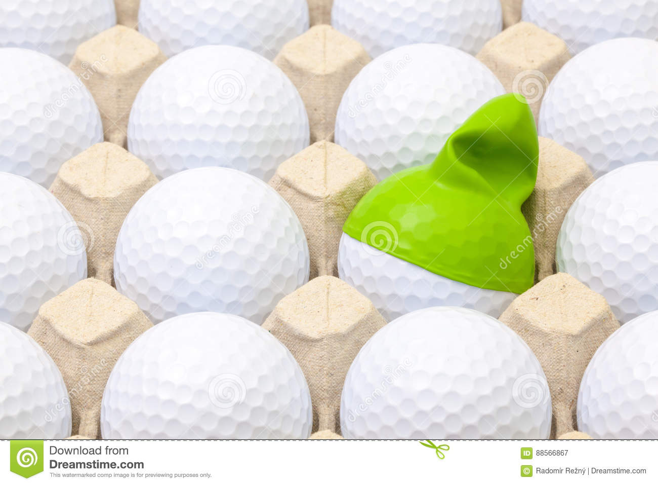 White golf balls in the box for eggs. Golf ball with funny cap.