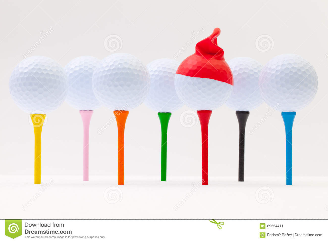 White golf balls with funny cap. Funny golf concept.