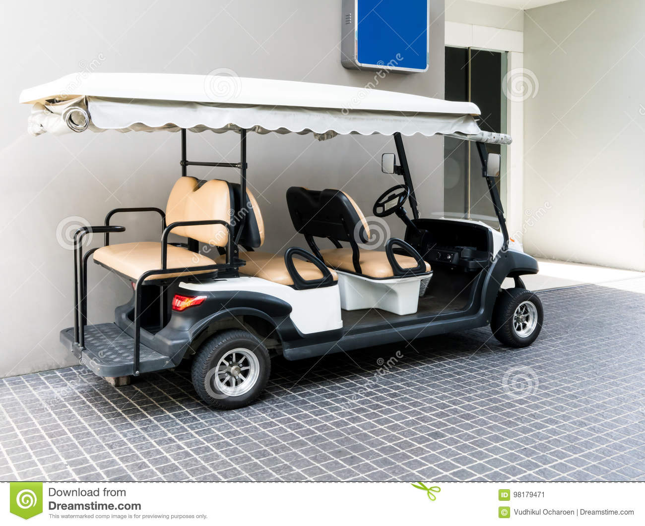 White Golf Cart With Back Seats In The Public Building Stock Image on golf players, golf tools, golf games, golf words, golf buggy, golf trolley, golf cartoons, golf card, golf girls, golf handicap, golf machine, golf hitting nets, golf accessories,