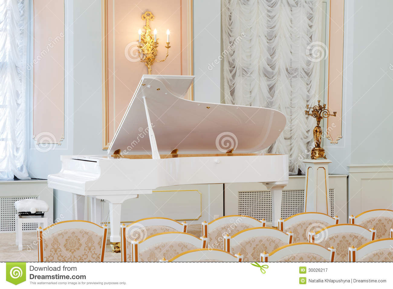 White Grand Piano On Concert Hall Royalty Free Stock