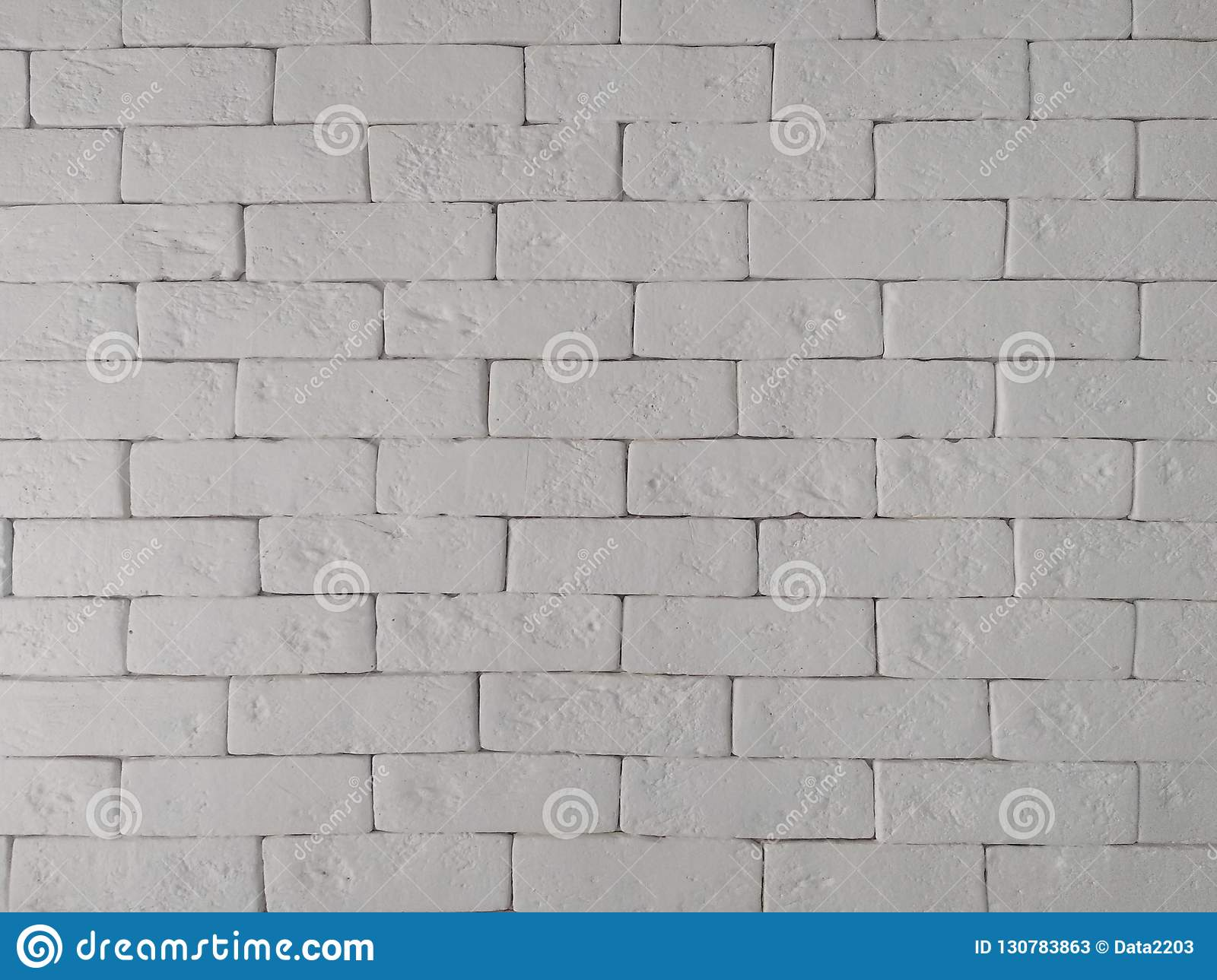 White and grey rough brick wall