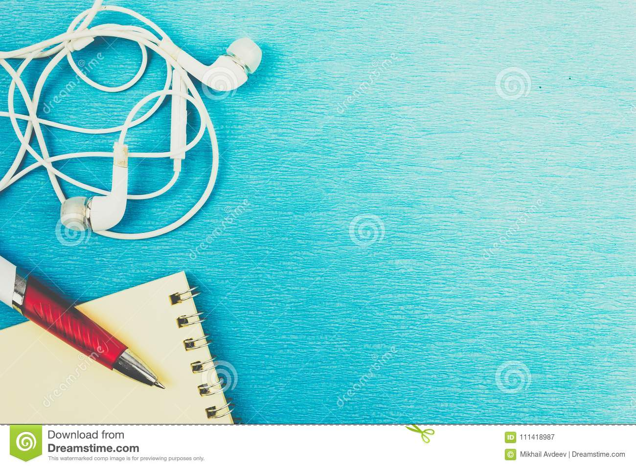 White headphones and wires on blue background.