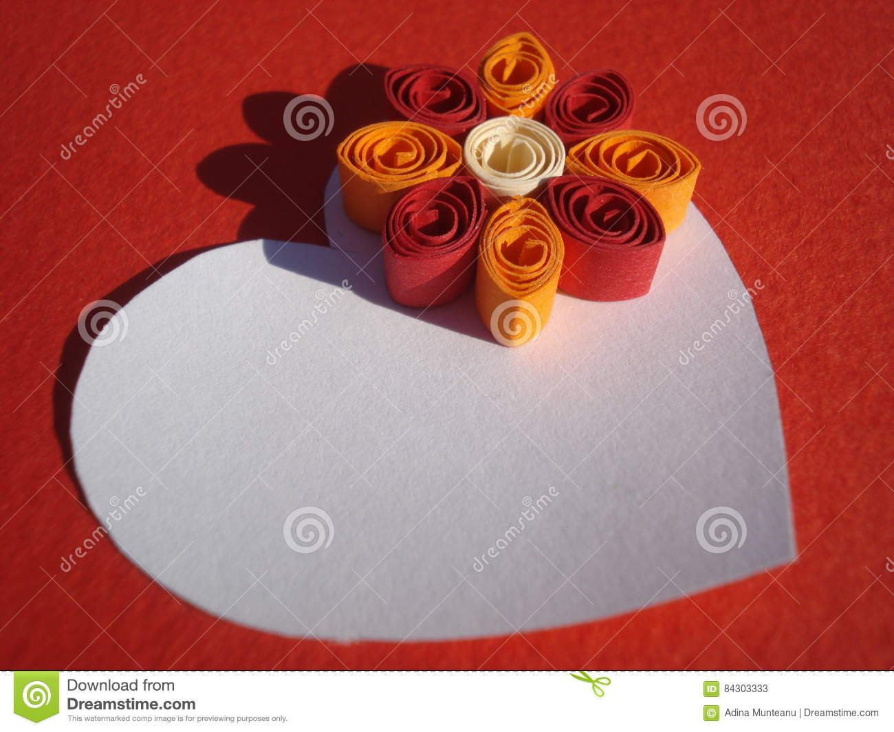 paper heart with space for message decorated with colorful quilling flower