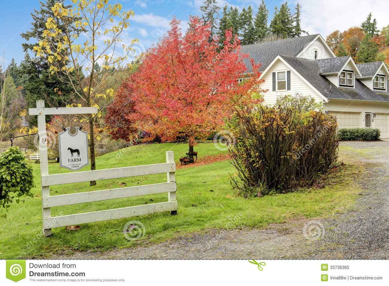 White Horse Farm American House During Fall With Green