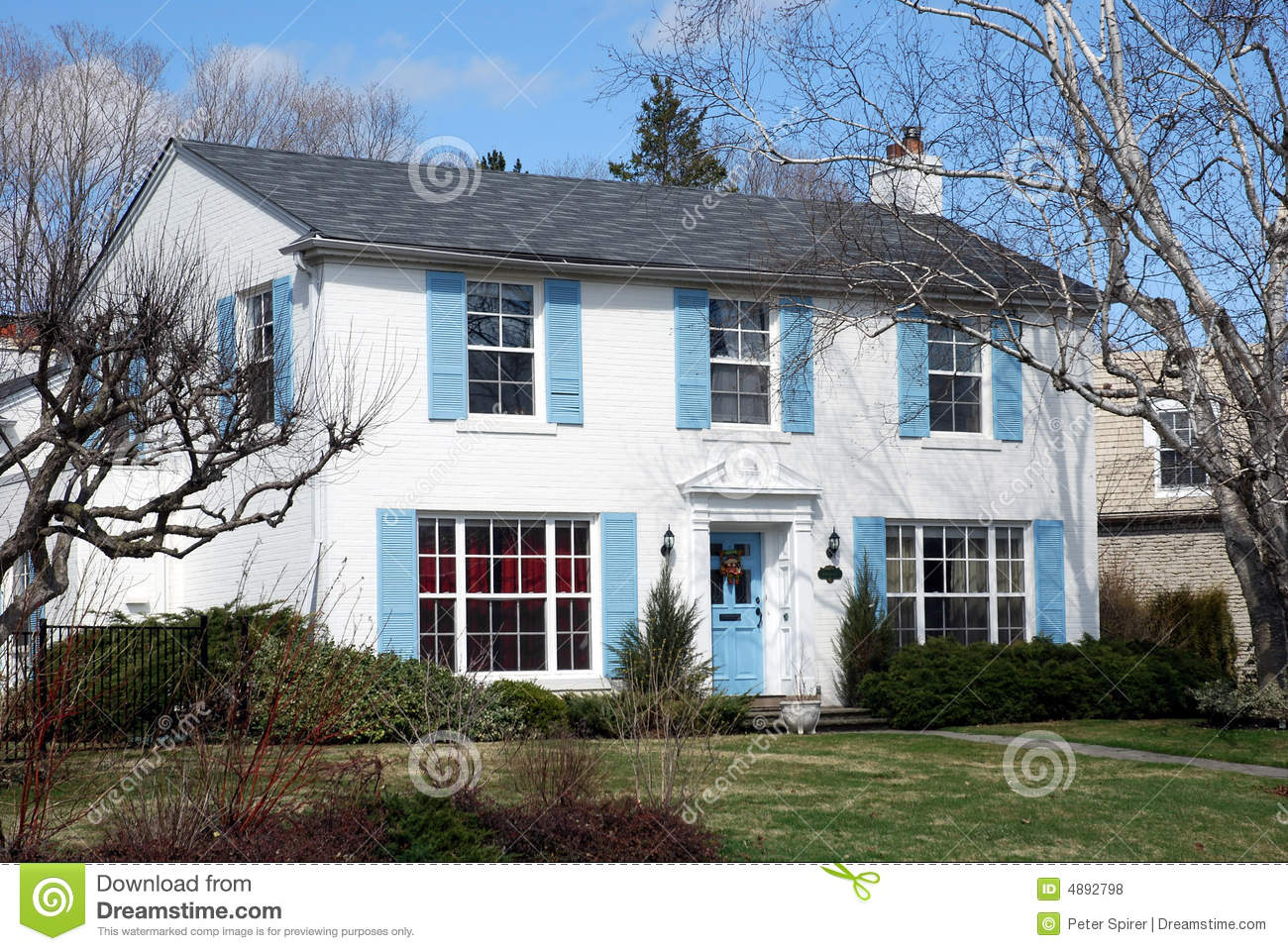 White House With Blue Shutters Royalty Free Stock Photos