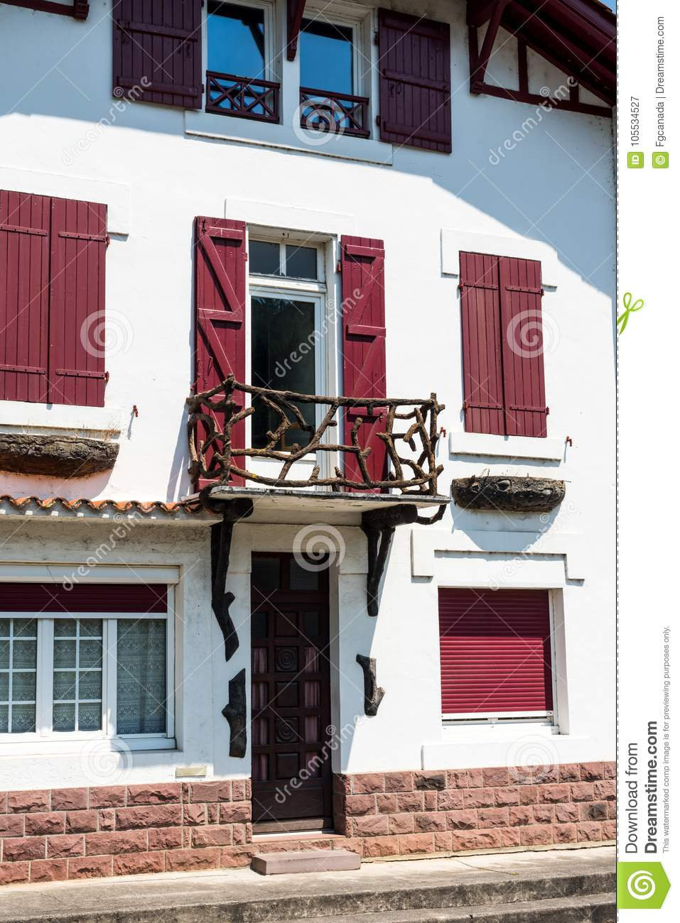 White House Facade With Red Shutters In Rural French
