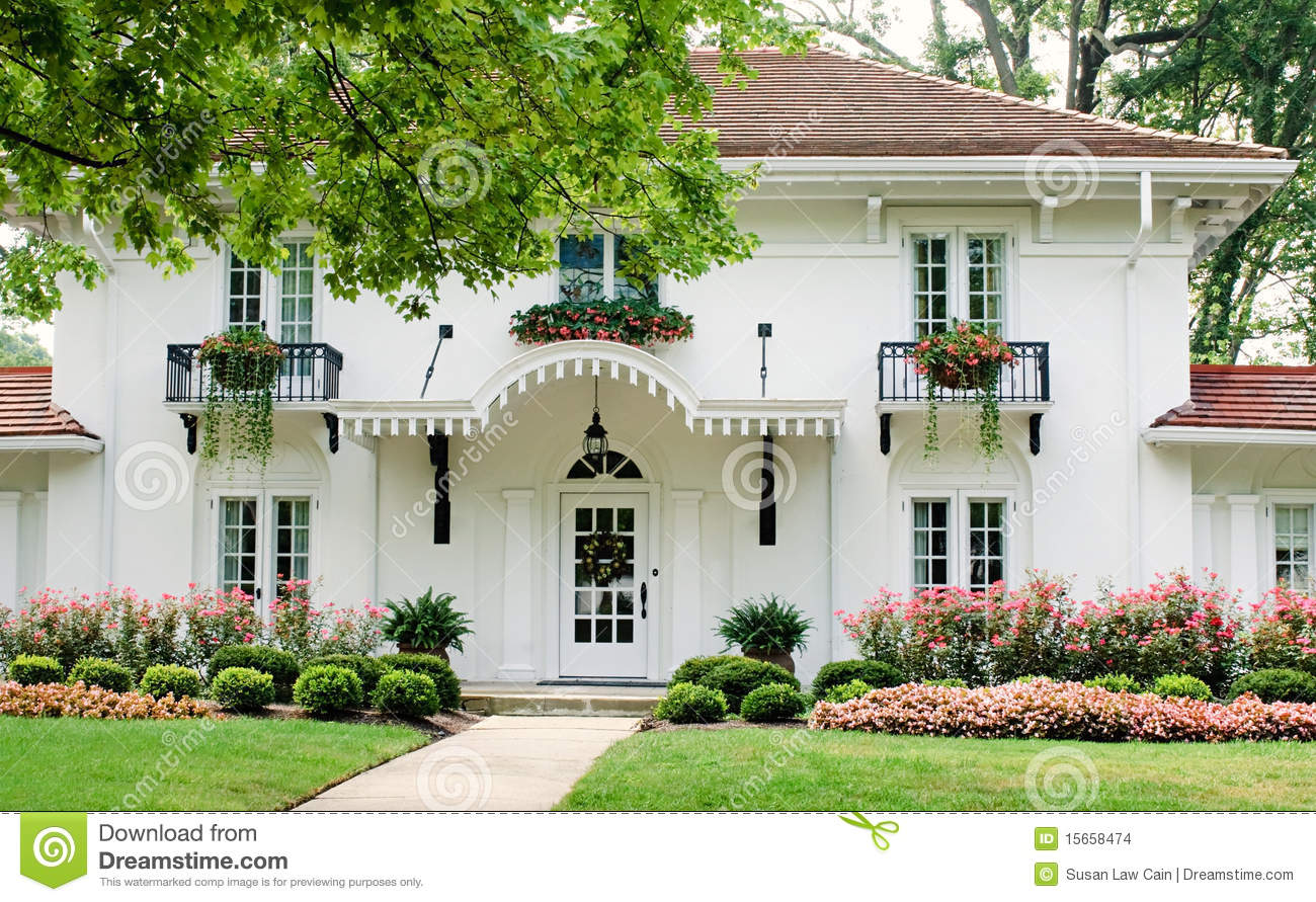 Midwest Living House Plans White House With Pink Flowers Stock Photo Image 15658474