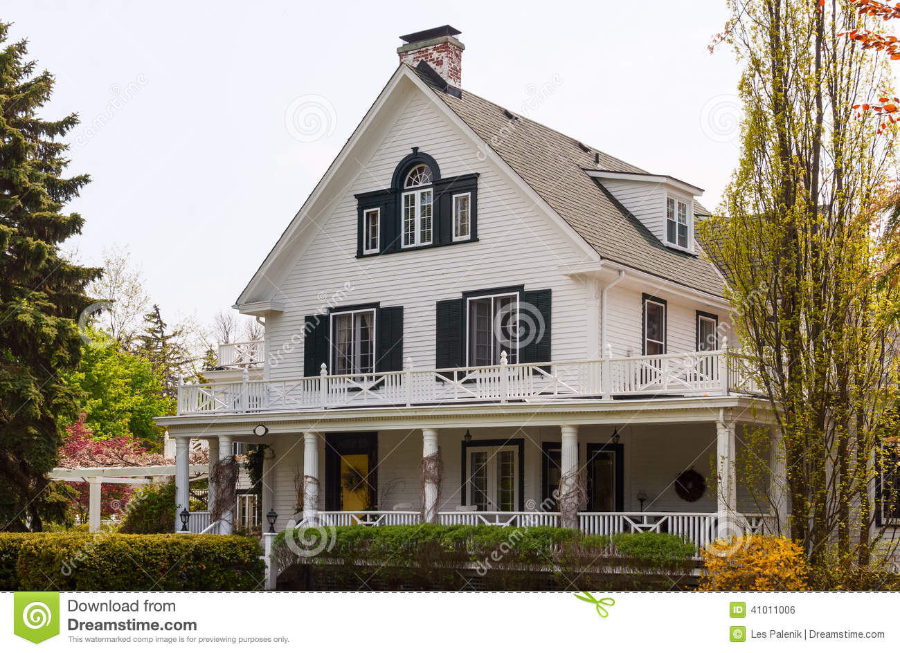 White house with a wraparound porch stock photo image of for House wrap prices