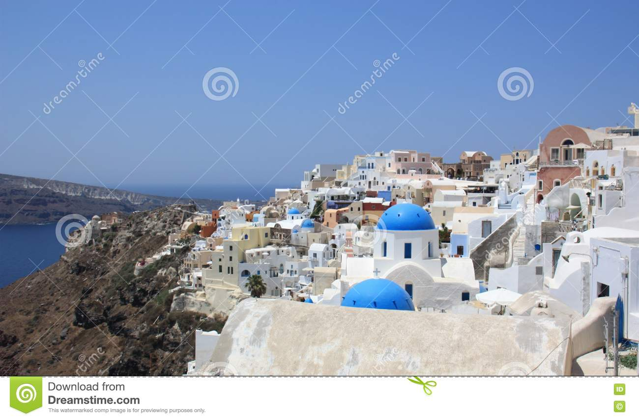 White Houses With Blue Roofs In Santorini Stock Photo