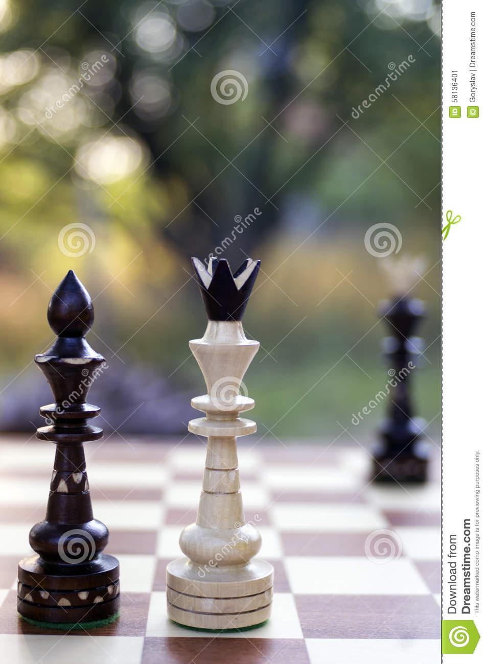 Stock photo white king and black queen chess pieces