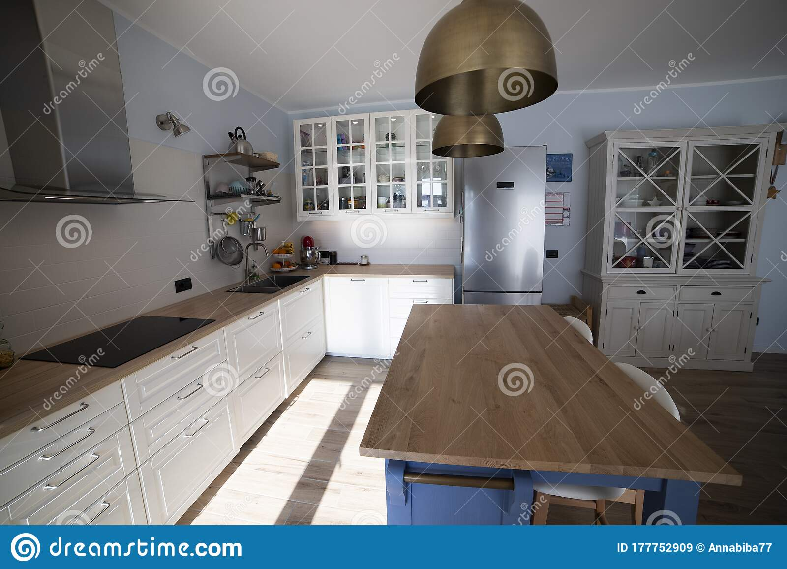 White Kitchen With Blue Island And White Cupboard Side View Stock Image Image Of Easygoing Beautiful 177752909