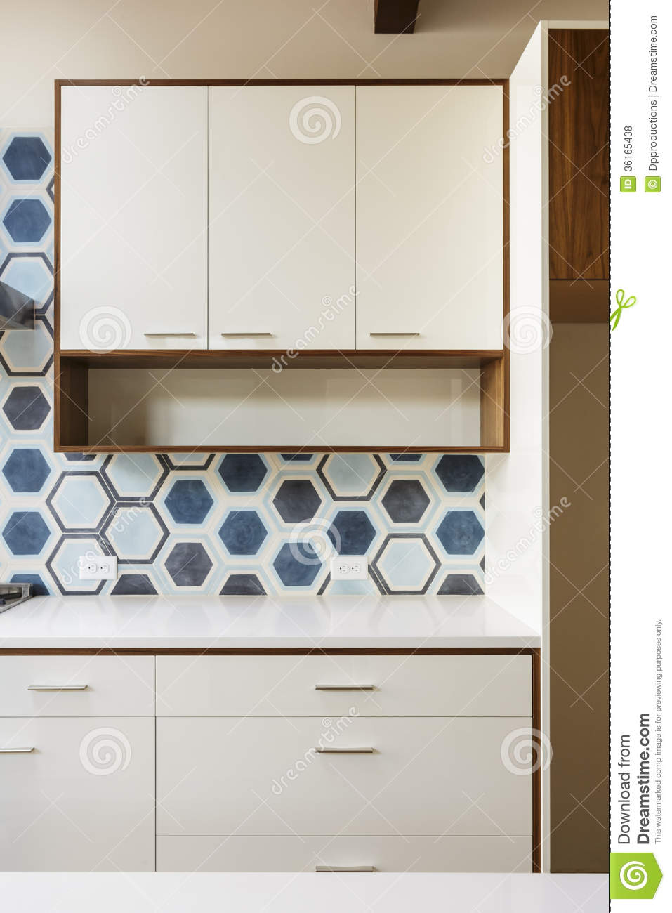 White kitchen cabinet in modern home with blue tile royalty free stock