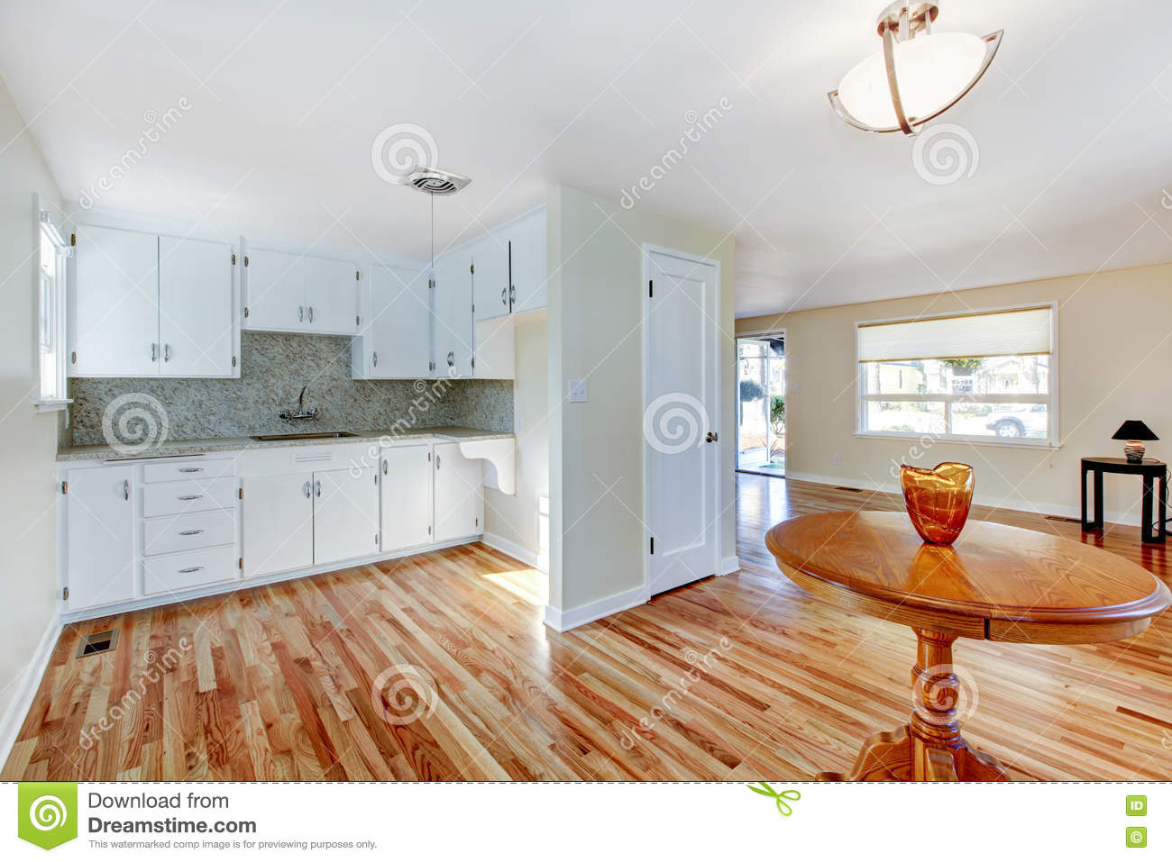 White Kitchen Cabinets With Light Tone Hardwood Floor