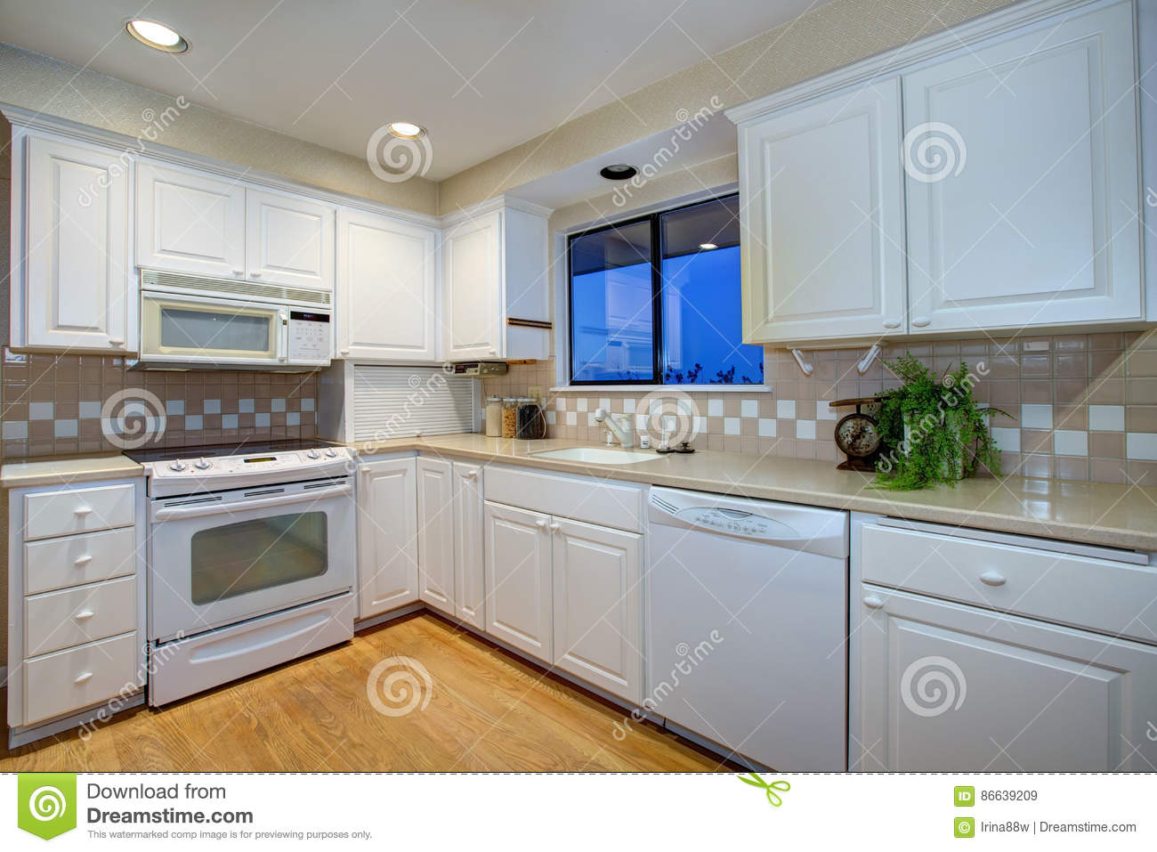 - White Kitchen Design With Hardwood Floor And White Appliances