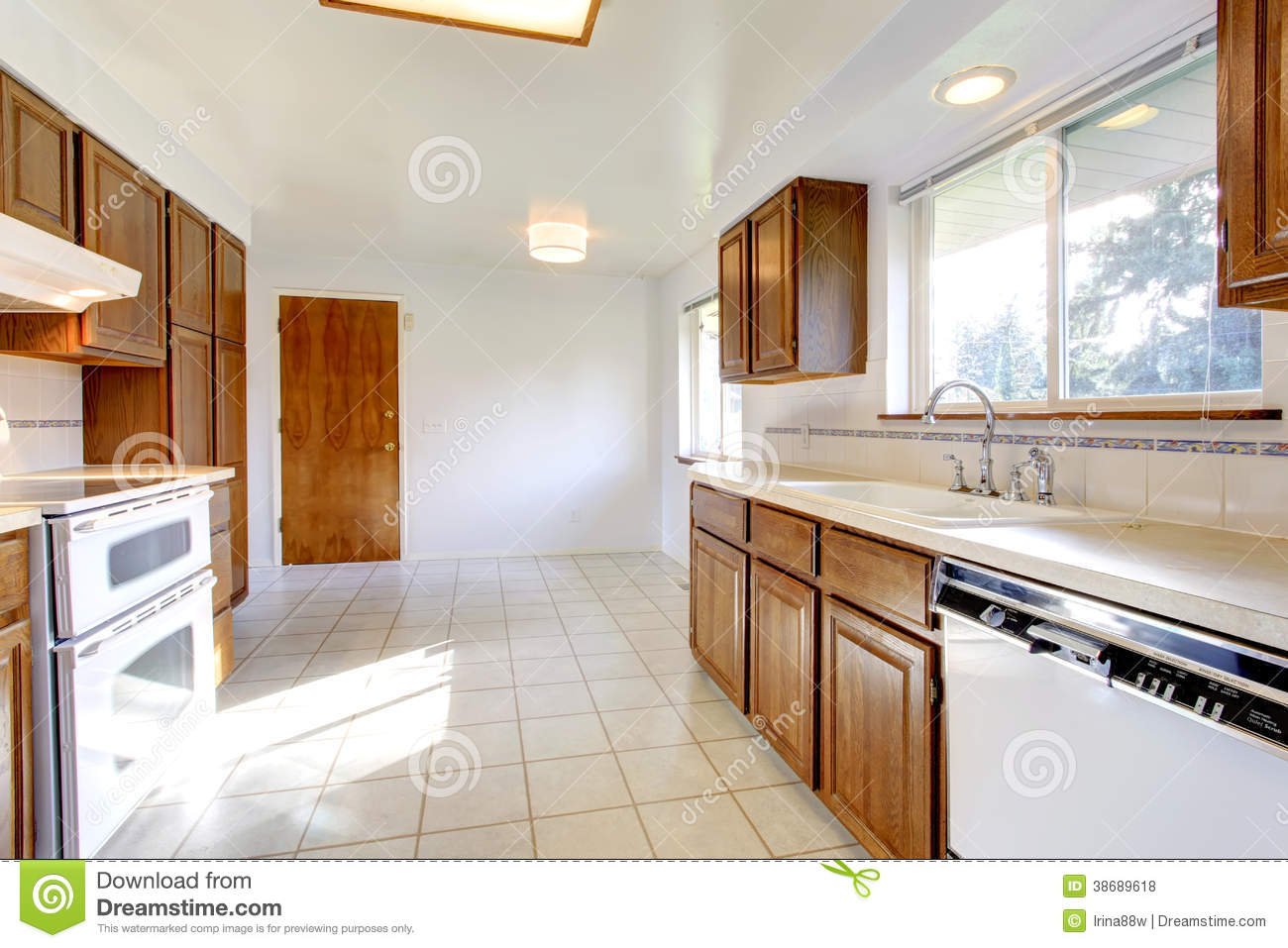 White Kitchen Room With Brown Cabinets Stock Photo Image Of White Cabinets 38689618