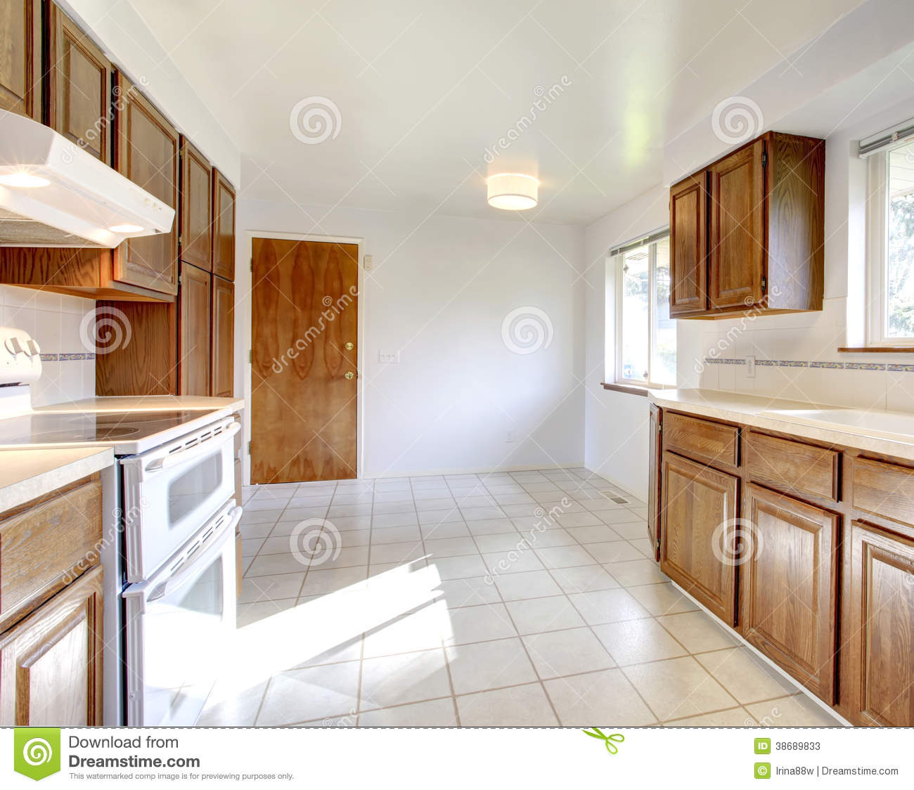 White Kitchen Cabinets Brown Tile Floor: White Kitchen Room With Brown Cabinets Stock Photos