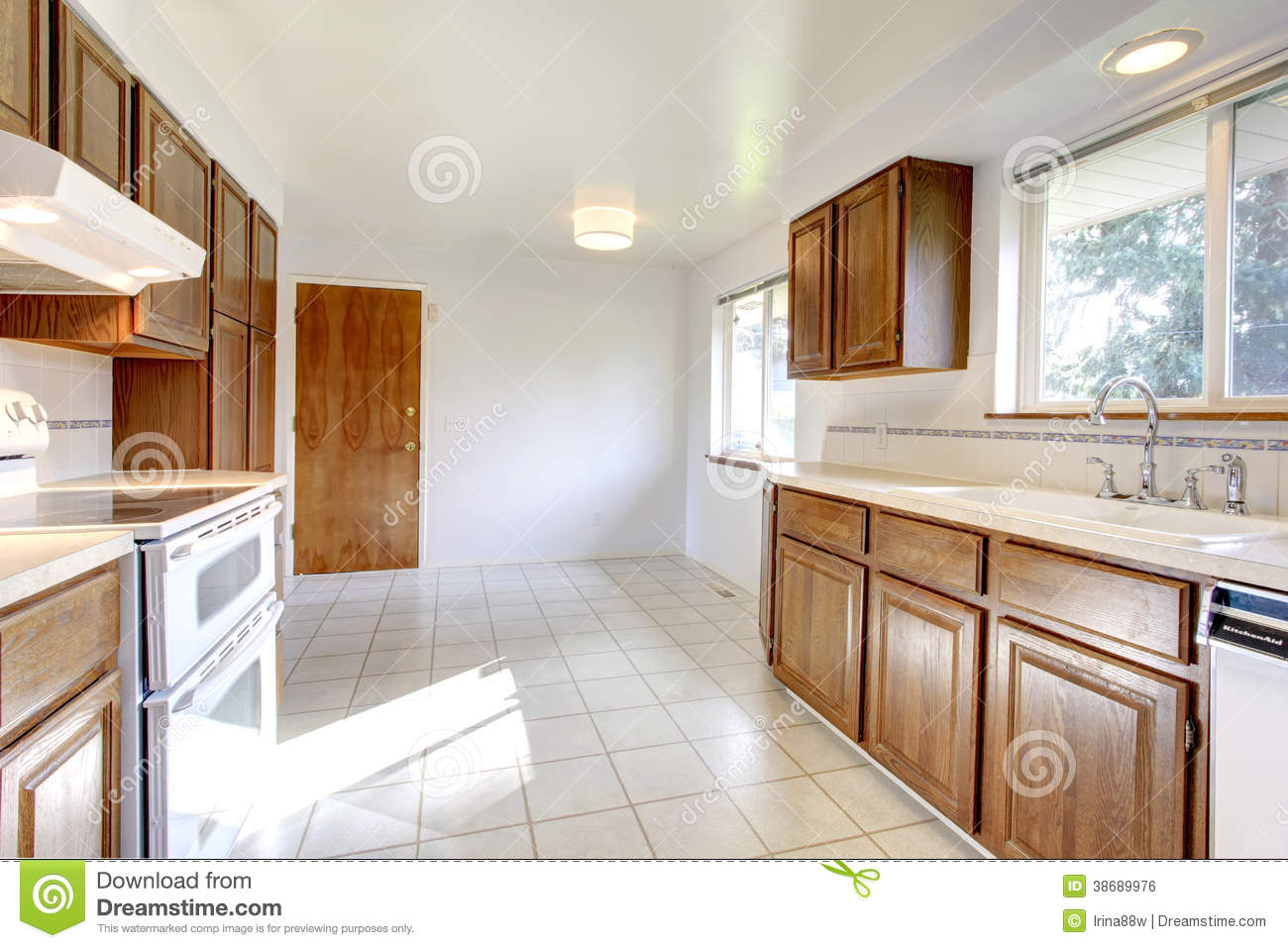 White Kitchen Room With Brown Cabinets Stock Photo