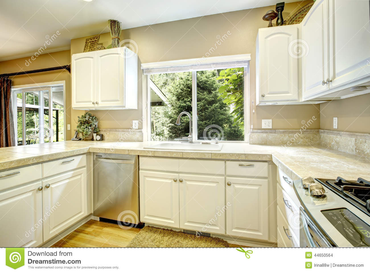 White kitchen cabinets with light tone hardwood floor for Cartoon kitchen cabinets