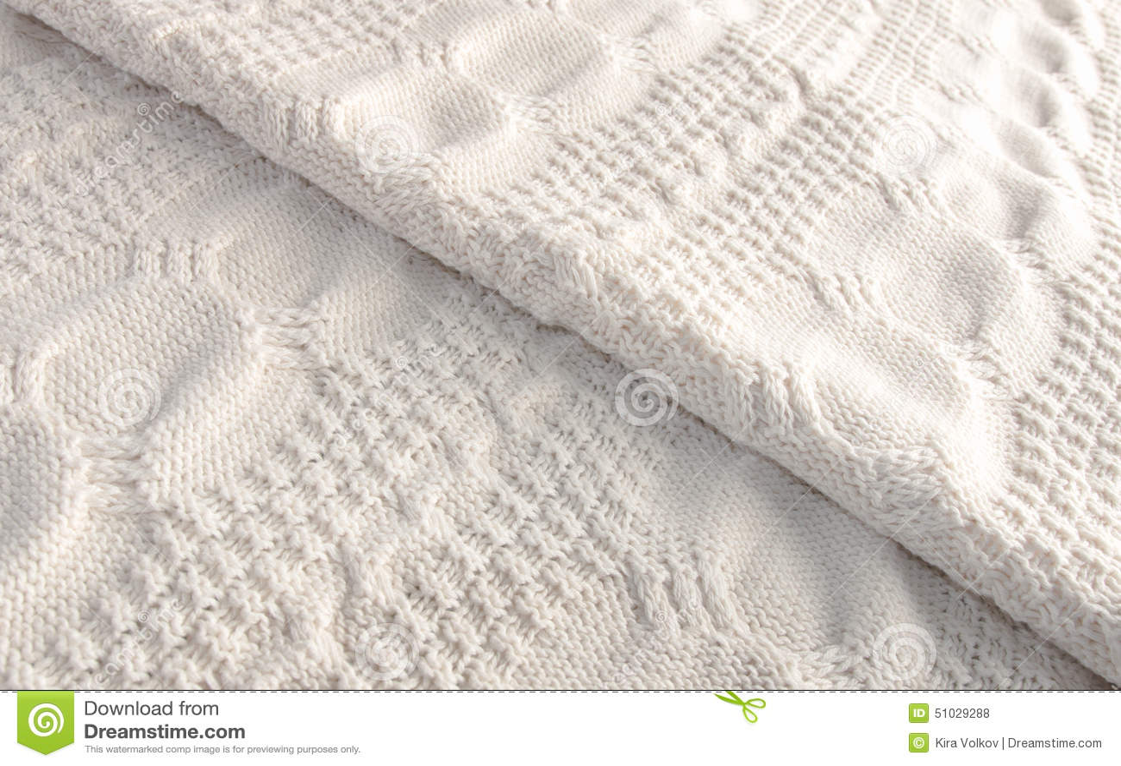 White Knitted Blanket Folded Diagonally Stock Photo
