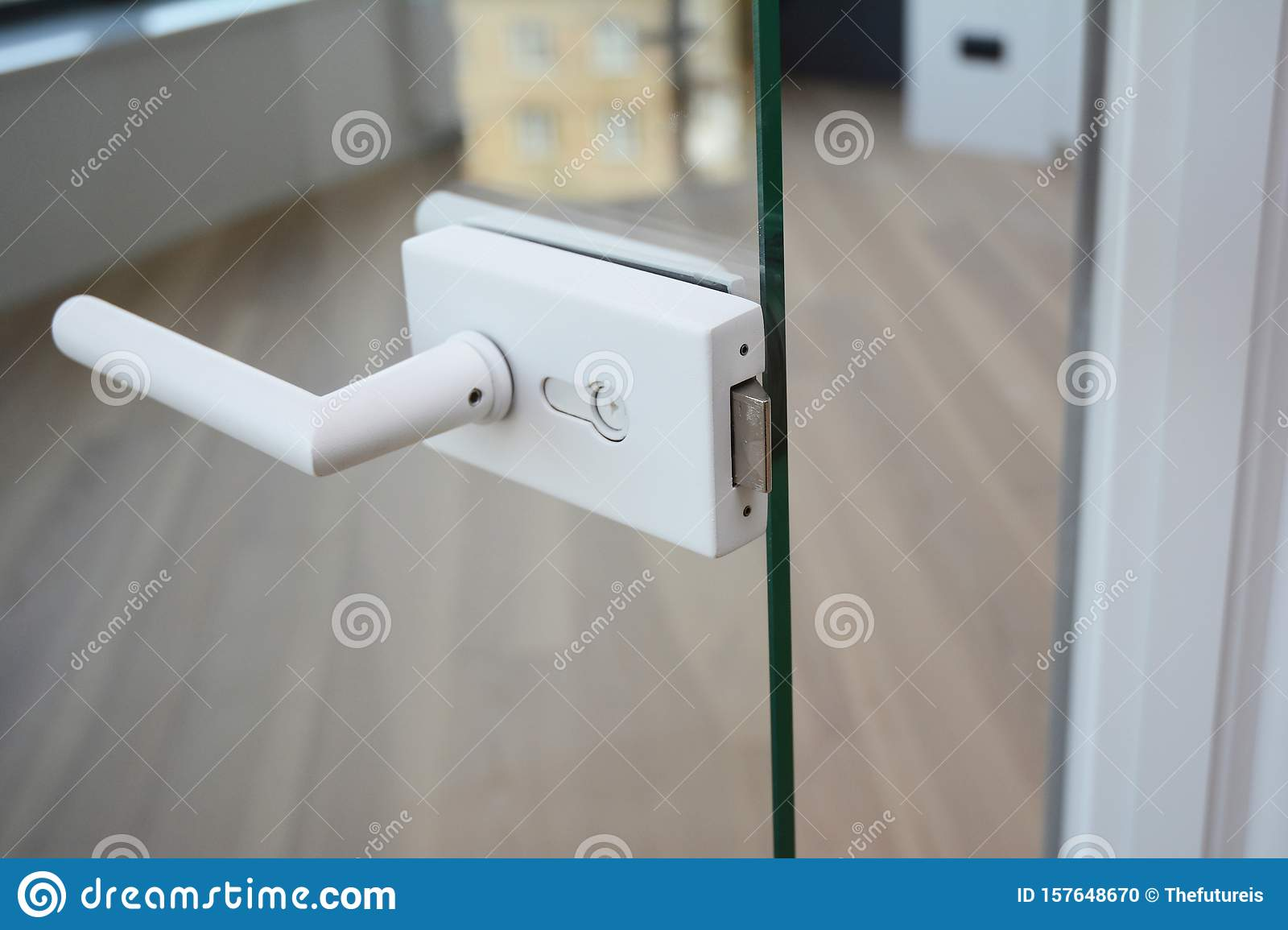 White Knob With Handle In Open Glass Door Modern Room Stock Photo Image Of Lock Knob 157648670