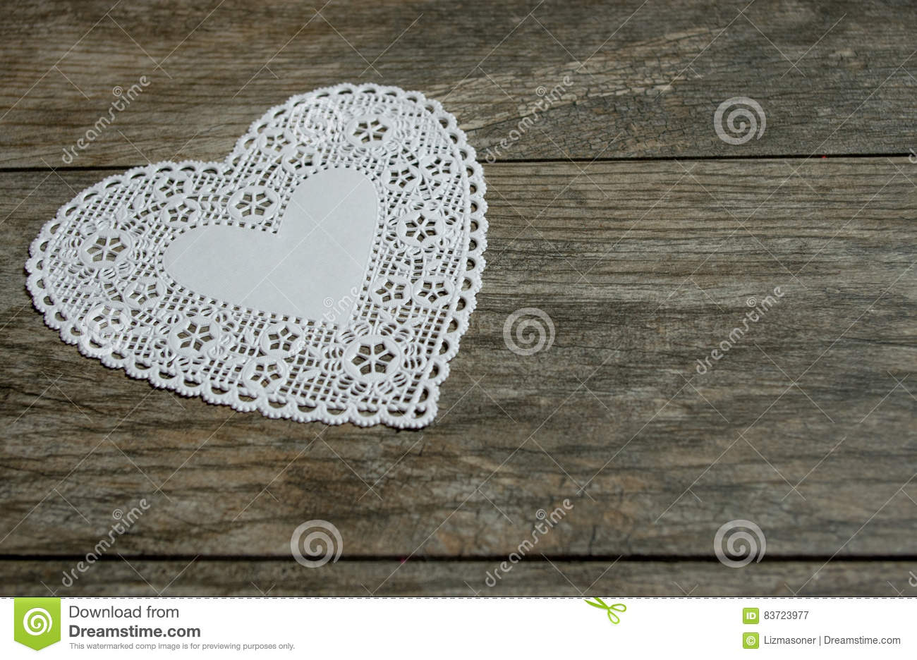 White Lace Heart On Distressed Wood Stock Photo