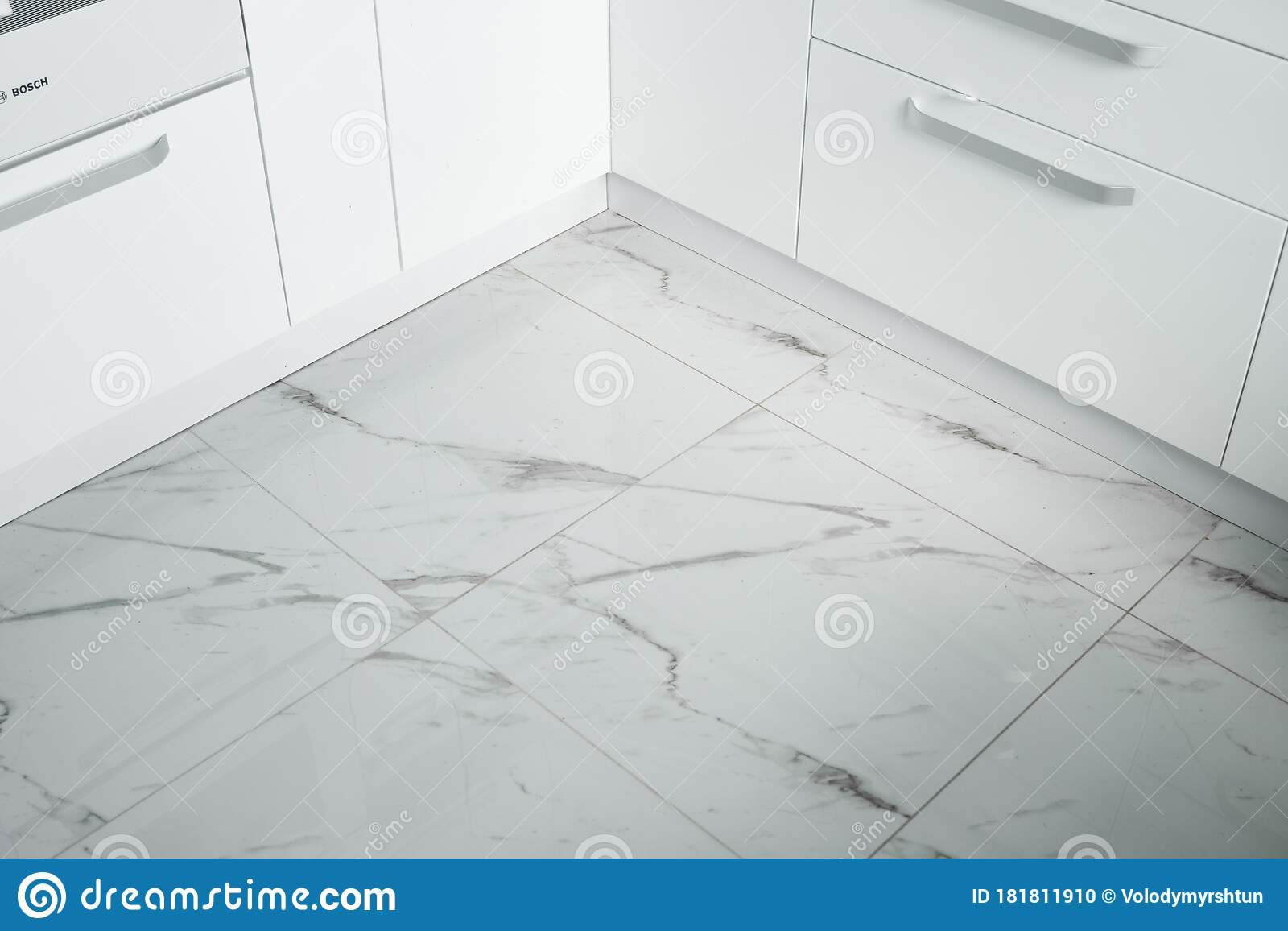 White Lacquered Kitchen Facades On A Comfortable Kitchen With A Marble Kitchen Tiles On The Floor Modern White Kitchen Stock Photo Image Of Beautiful Flat 181811910