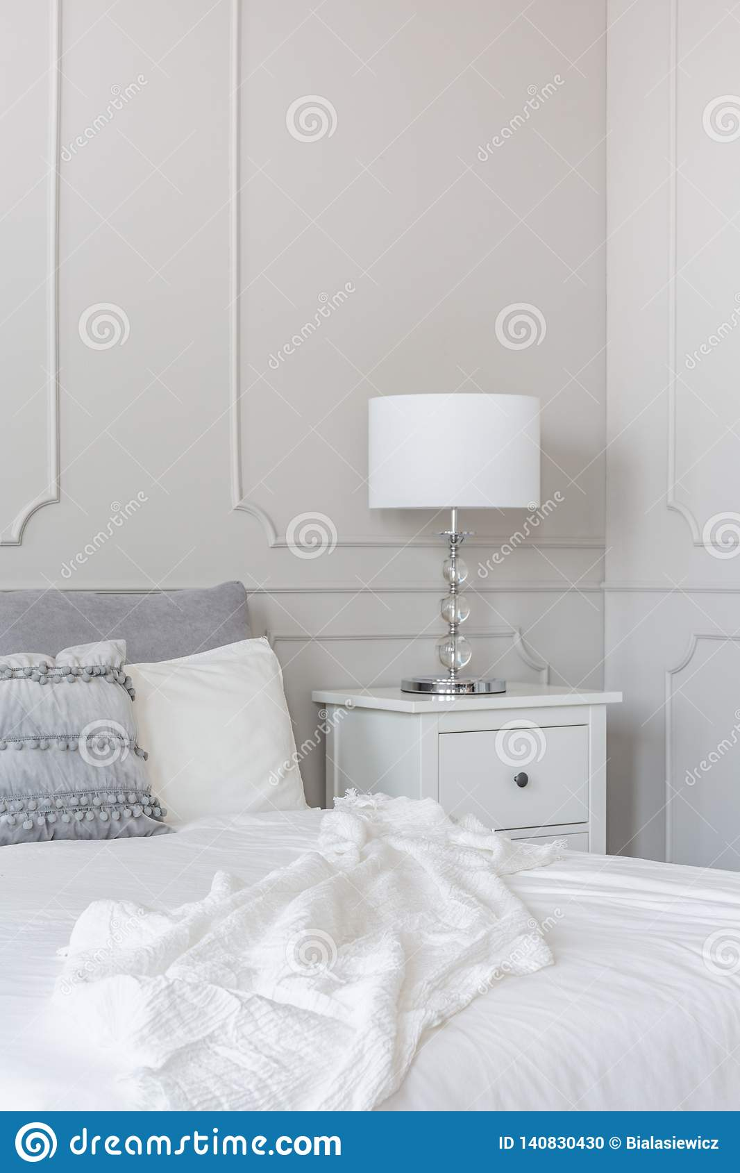 White Lamp On Wooden Nightstand Next To King Size Bed Copy