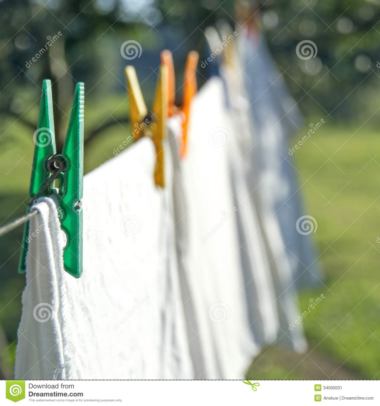 Clothes Drying On A Clothesline ~ White laundry drying on a clothesline stock image