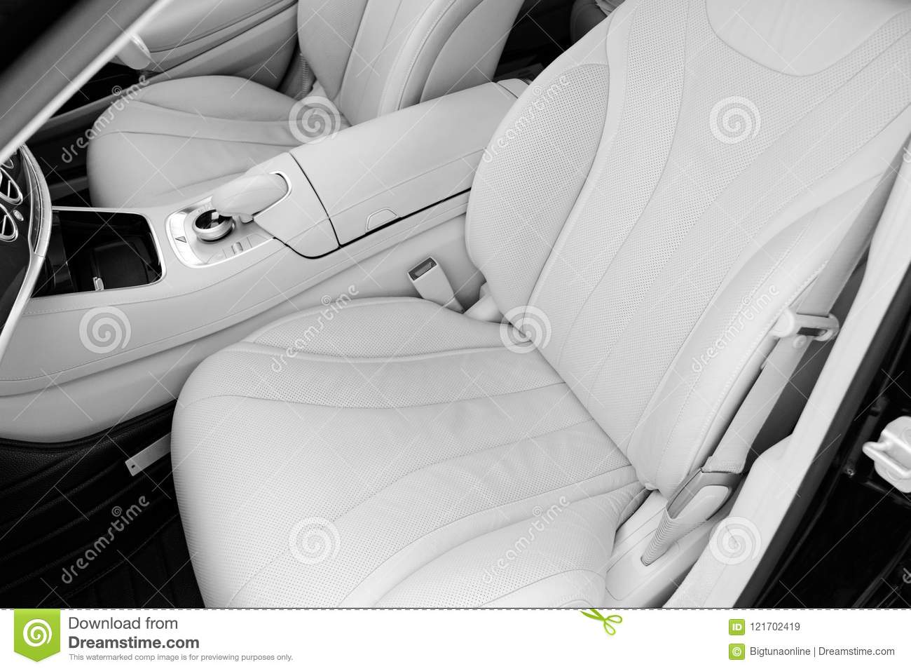 White leather interior of the luxury modern car. Leather comfortable white seats and multimedia. Steering wheel and dashboard. Aut