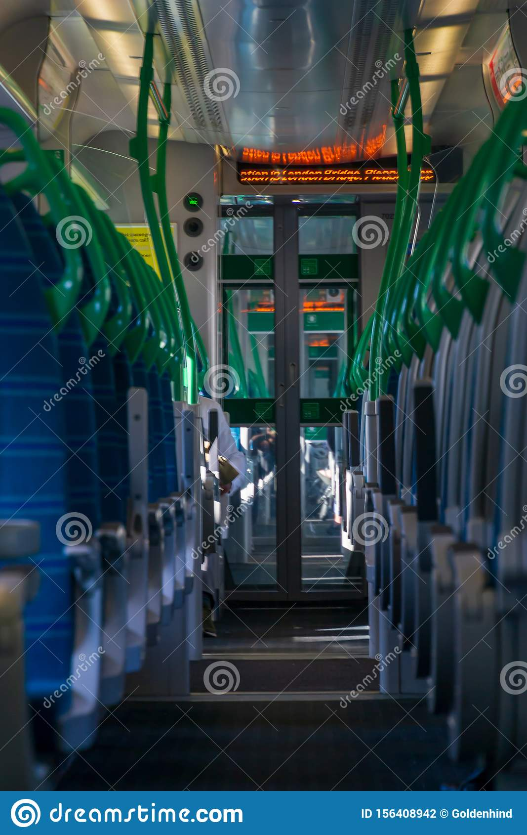 White light panoramic view interior of a high speed electric modern train with blue seats