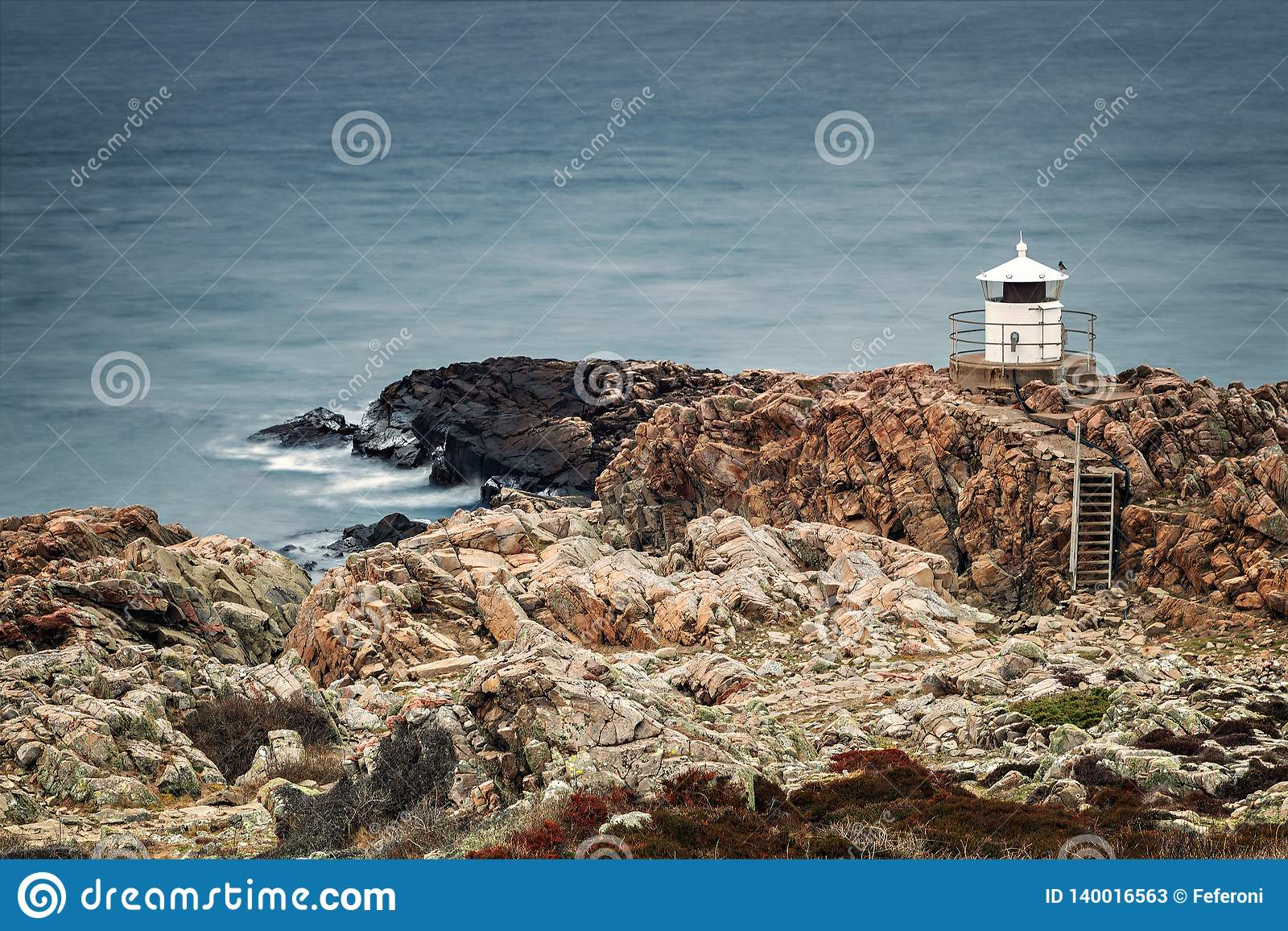 White lighthouse on cliffs stock image  Image of hiking