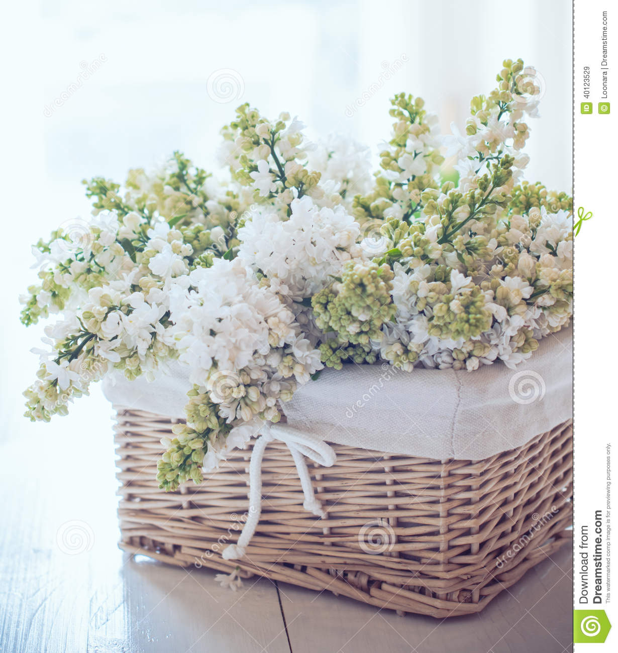 White lilac flowers in a wicker basket stock photo image - Decoracion shabby chic vintage ...
