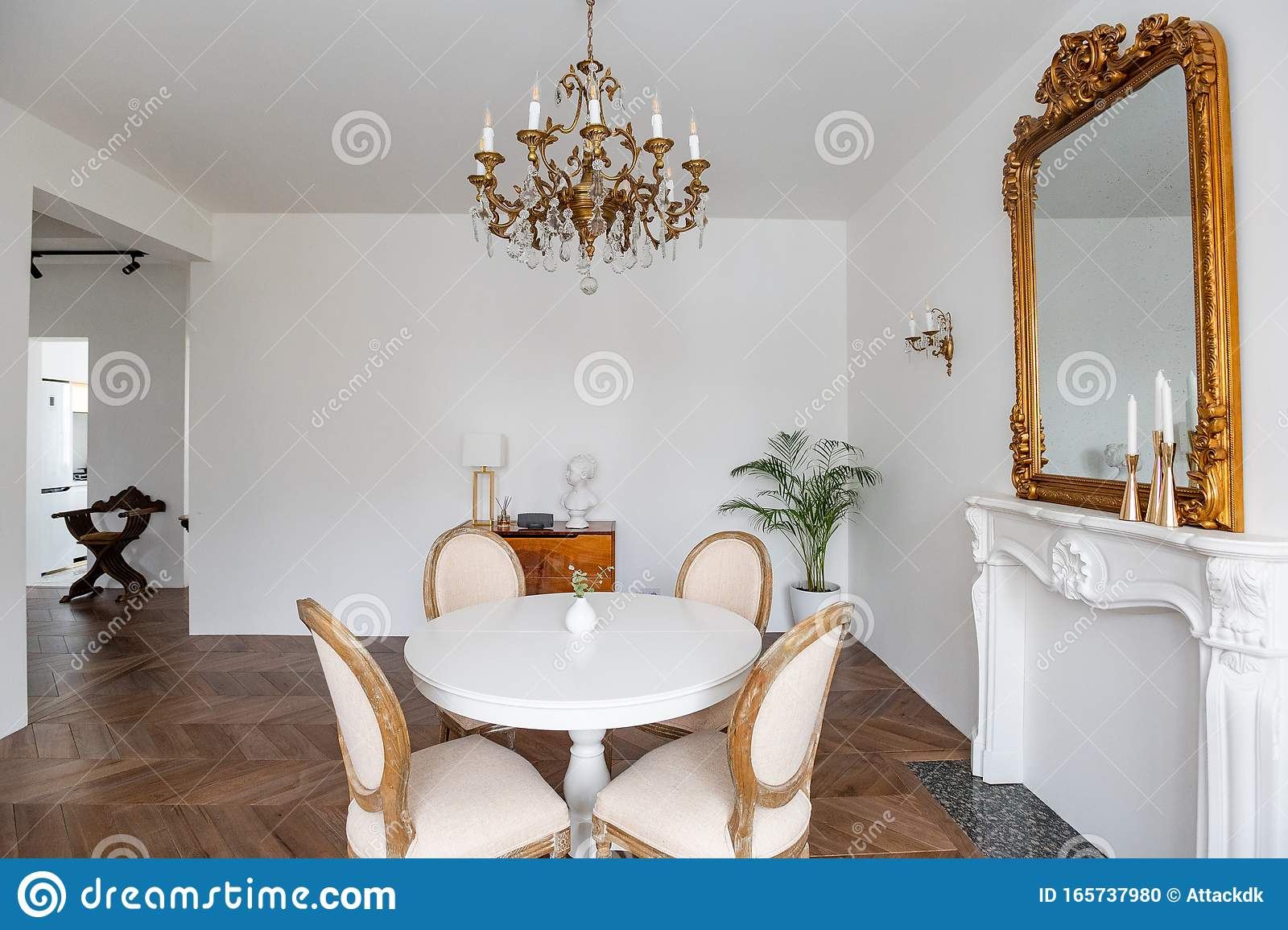 White Living Room With Classic Decor Mirror Fireplace Dining Table Stock Photo Image Of Living Cover 165737980