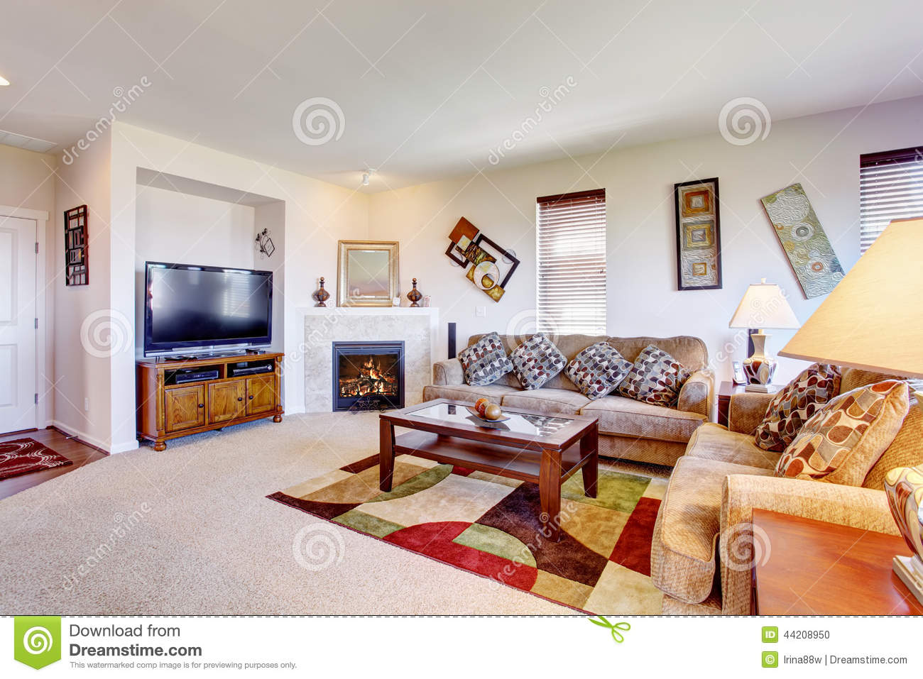 White Living Room With Fireplace And Colorful Rug Stock Photo ...