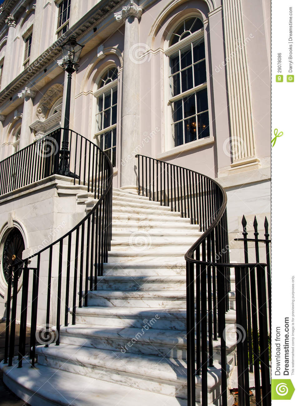White Marble Steps Between Black Iron Banister Stock Photo