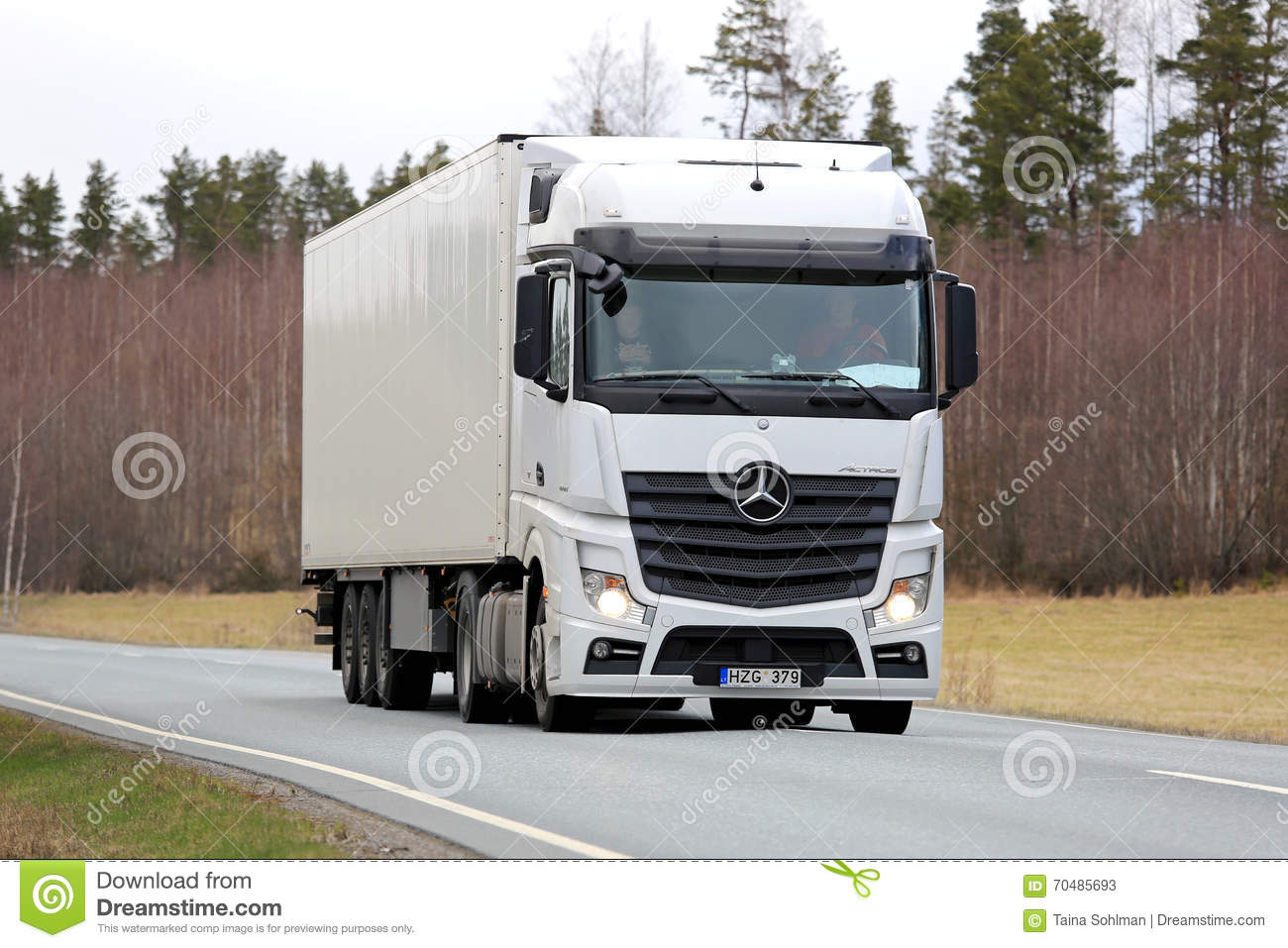 white mercedes benz actros semi truck on spring road