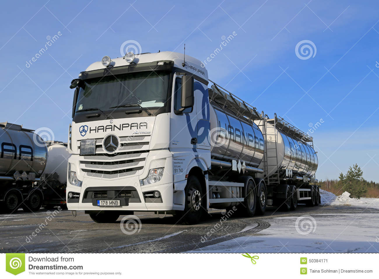 white mercedes benz actros tank truck on icy yard