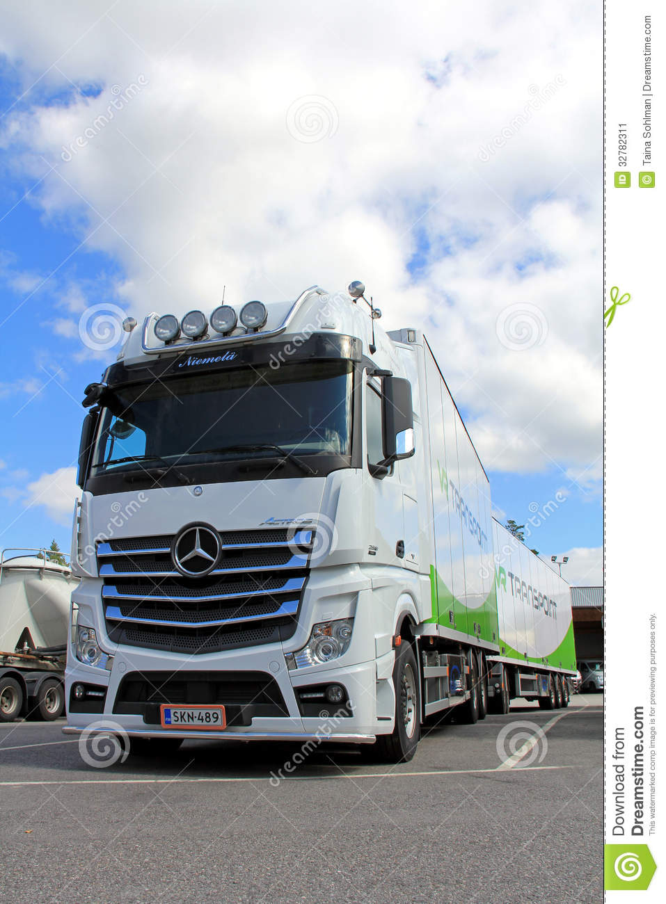 white mercedes benz actros truck and trailer editorial