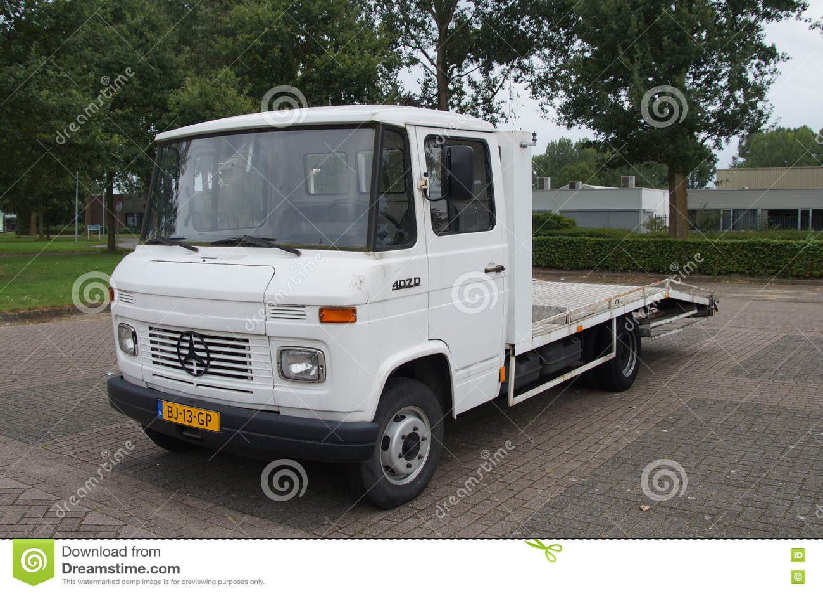 White mercedes benz l 407 d car trailer truck editorial for Mercedes benz parking