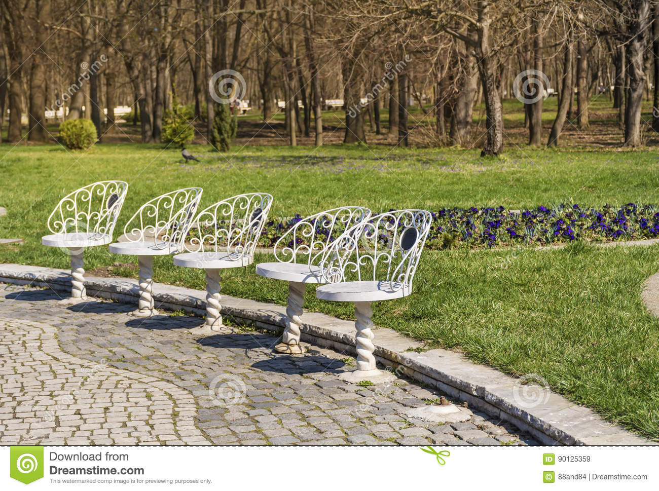 Superb White Metal Chairs In A Spring Park With Blooming Flowers Machost Co Dining Chair Design Ideas Machostcouk