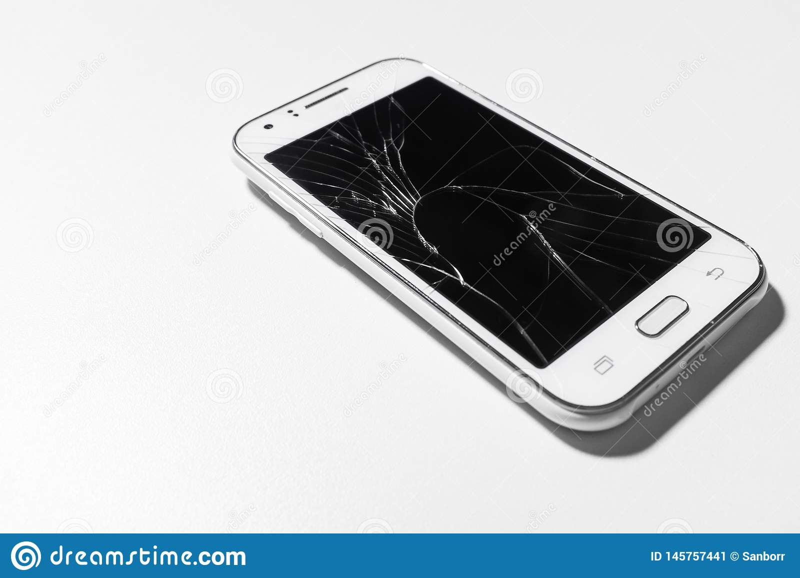 A white mobile phone is broken screen on white background.blank for copy space
