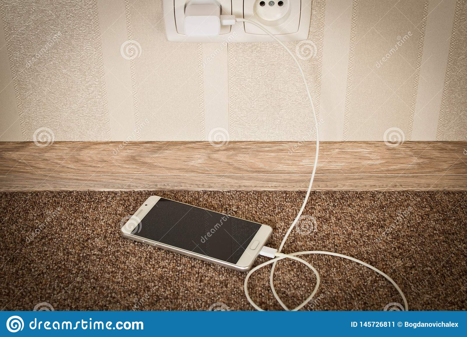 White mobile phone charging. Smartphone on charge