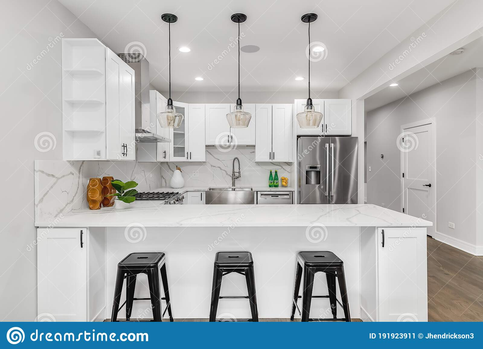 A White Modern Kitchen With Black Lights Stools And Hardware Editorial Photo Image Of Contemporary Kitchen 191923911