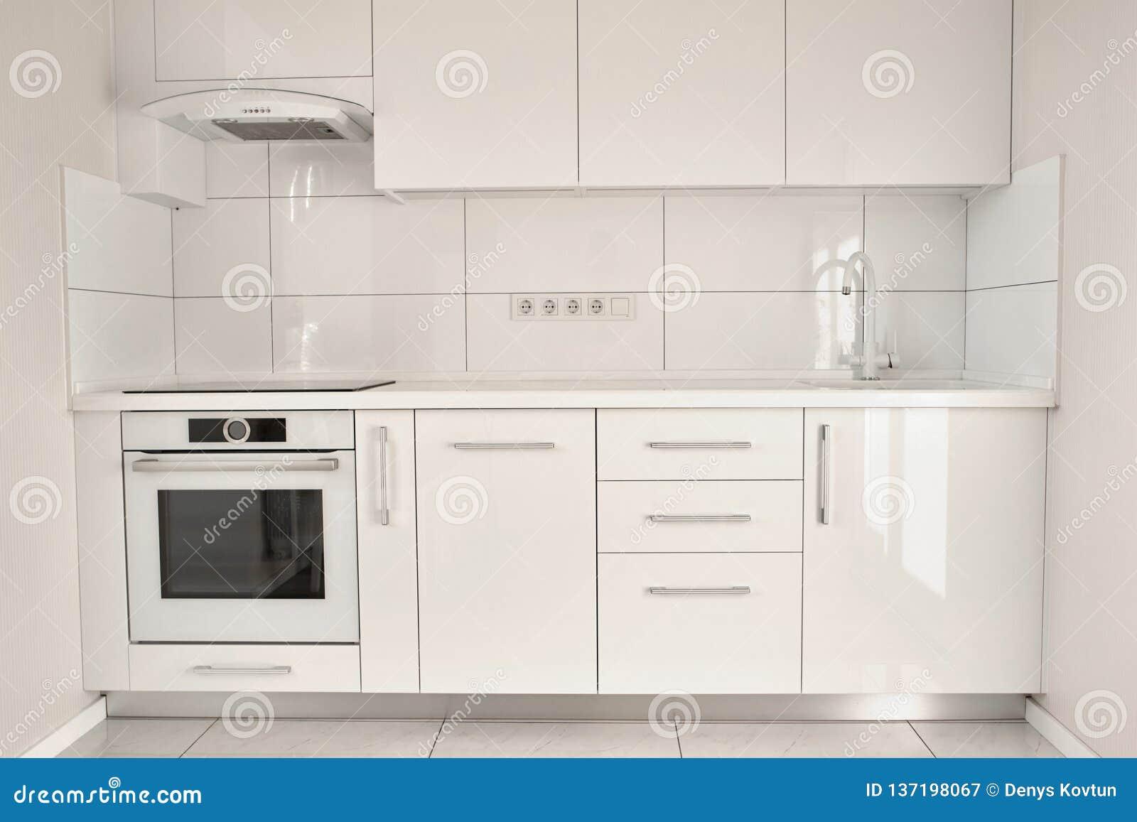White modern kitchen in contemporary flat.