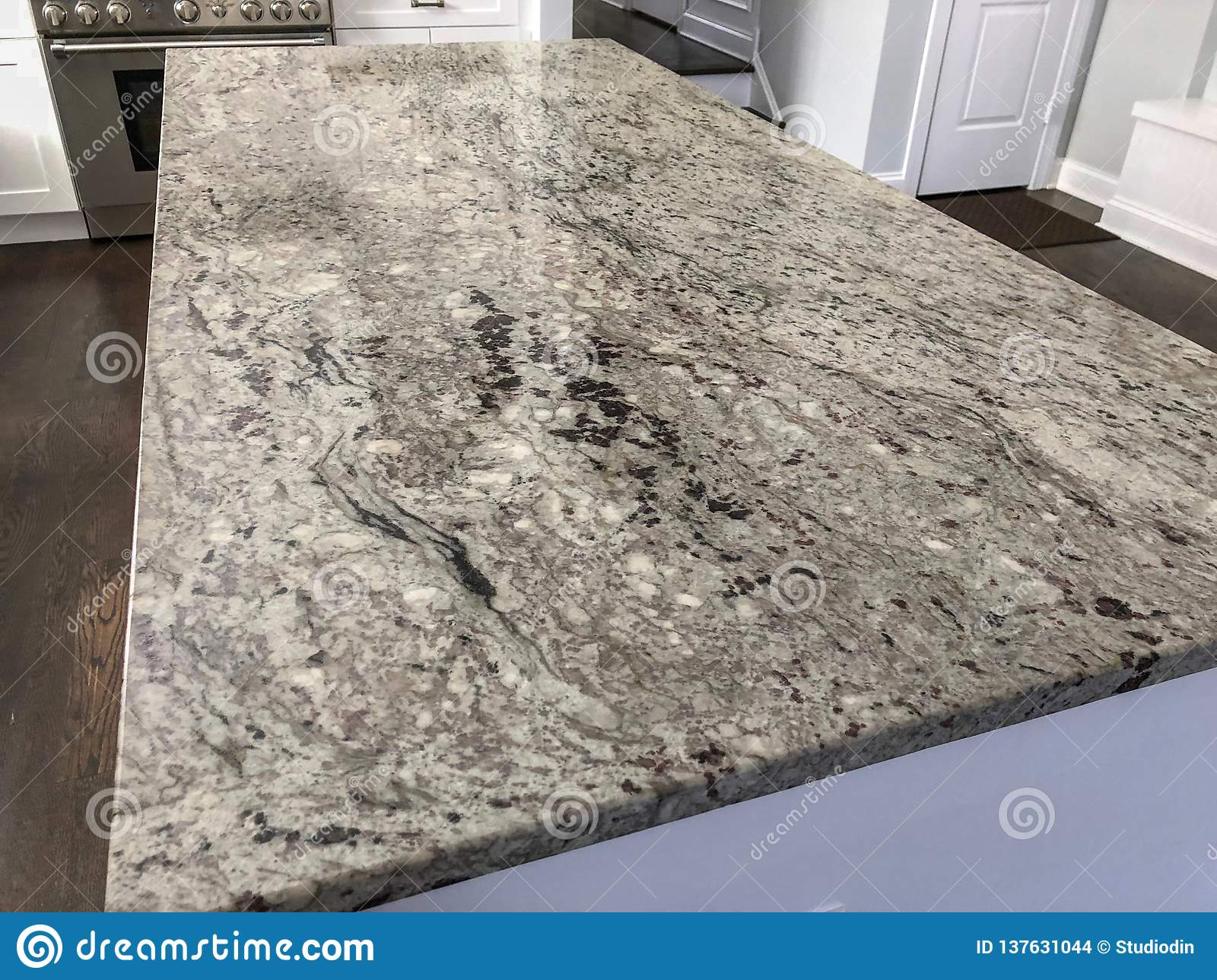 White Modern Kitchen With Granite Countertop Island In The Midle Of The Kitchen Stock Photo Image Of Appliances Marble 137631044