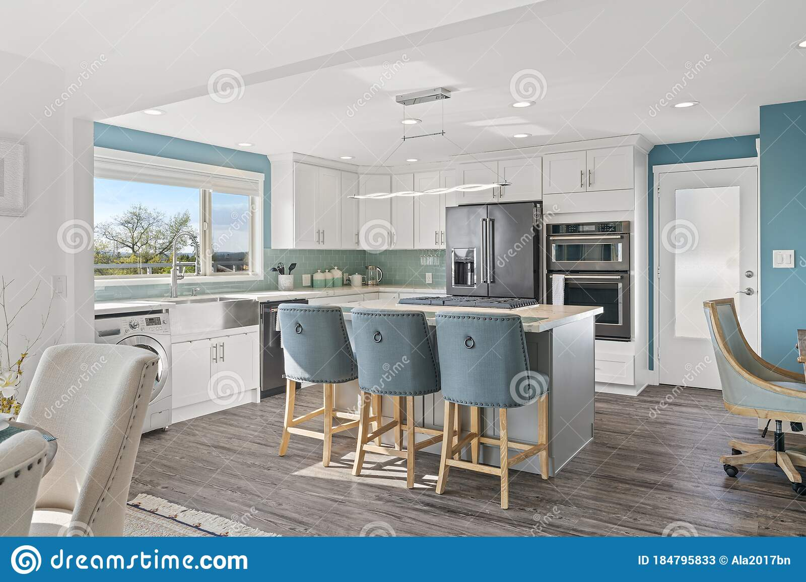 Picture of: White Modern Kitchen Interior With Navy Blue Accents Stock Image Image Of Modern Oven 184795833