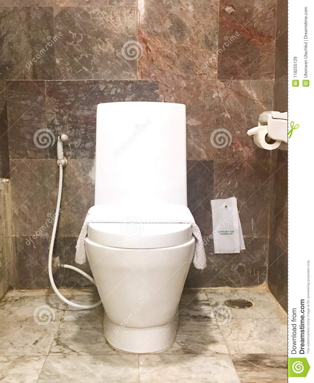White Modern Toilet Bowl Against Brown Marble Wall Stock Image Image Of House Wash 118255129