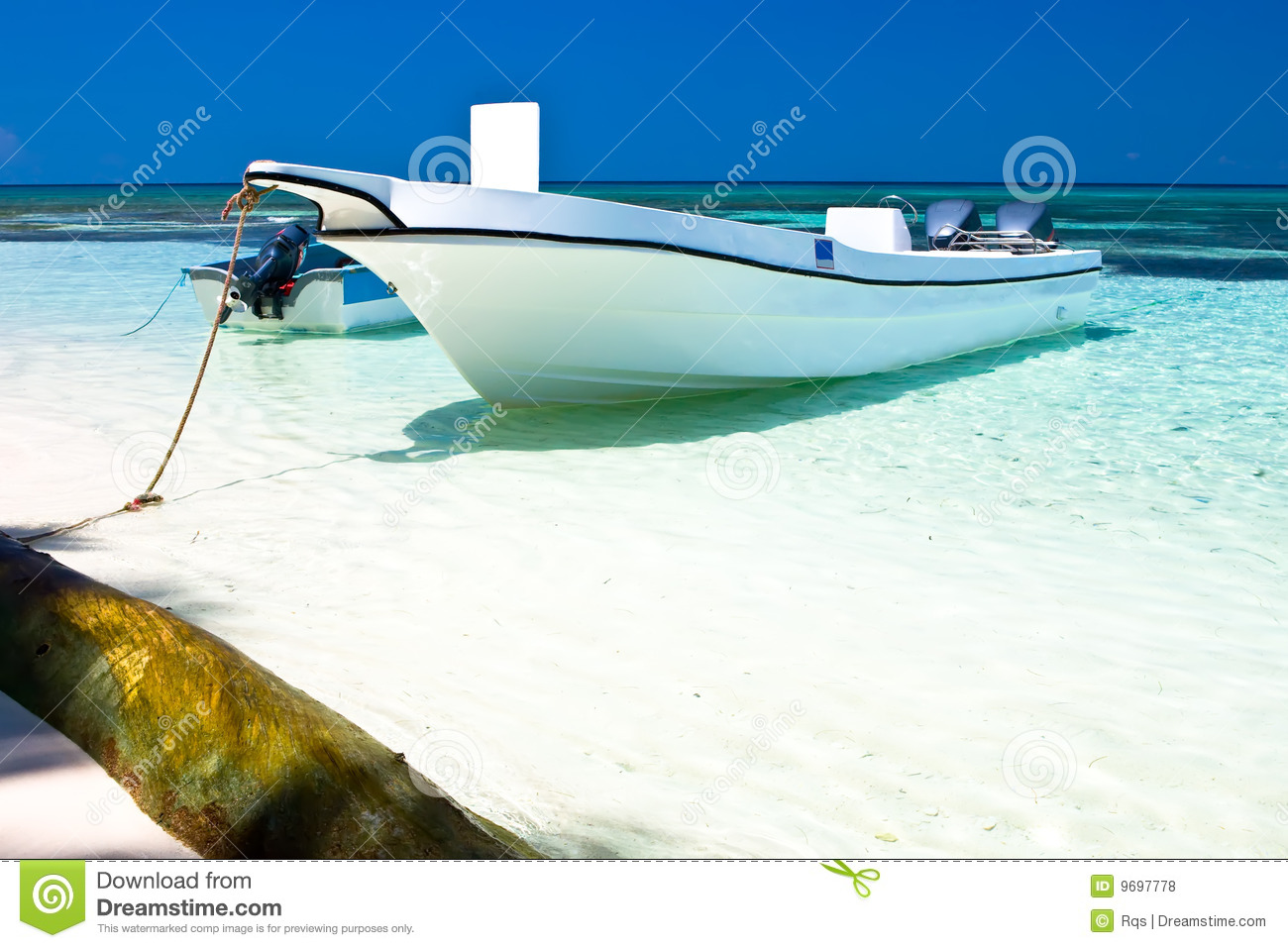 White Motor Boat On A Sand Beach In The Ocean Royalty Free ...