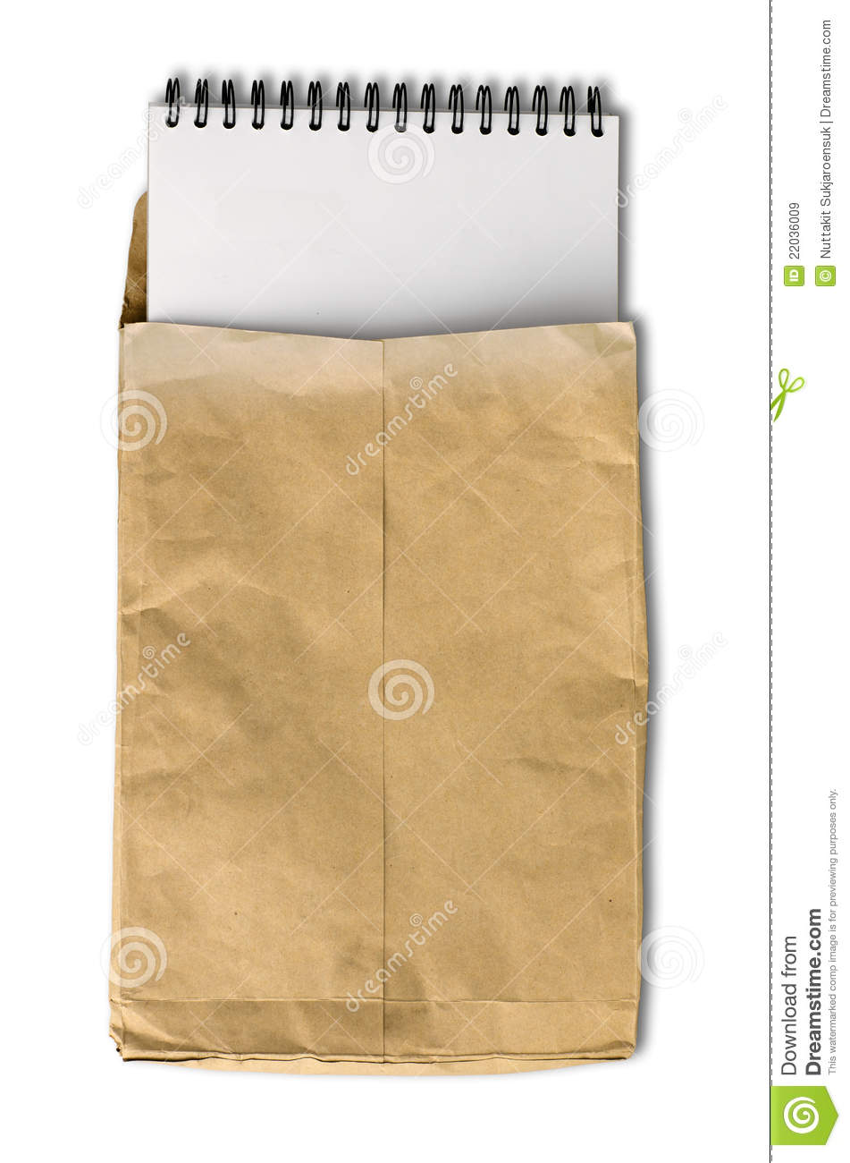 White note book in wrinkled brown paper envelope